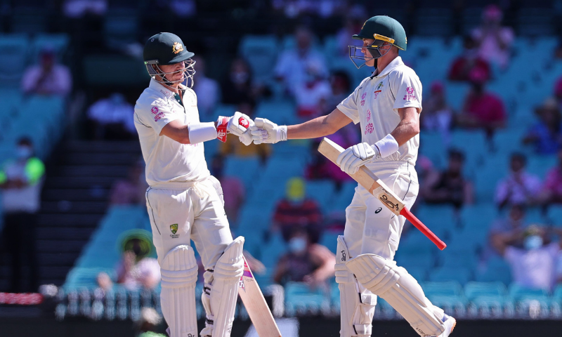 Australia's David Warner (L) and his teammate Marnus Labuschagne celebrate a boundary on the third day of the third cricket Test match between Australia and India at the Sydney Cricket Ground (SCG) in Sydney on Saturday. — AFP