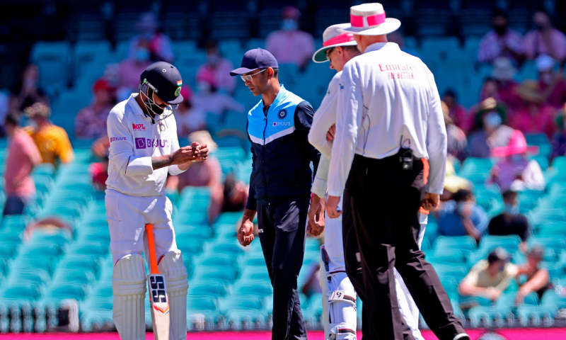 India's Ravindra Jadeja (L) holds his hand after he was hit by the ball on the third day of the third cricket Test match between Australia and India at the Sydney Cricket Ground (SCG) in Sydney on Saturday. — AFP
