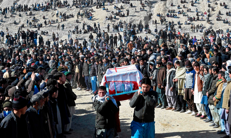 Mourners from the Shia Hazara community carry the coffin of one of the miners, who was killed in an attack by gunmen in the mountainous Machh area, during a funeral procession at a graveyard in Quetta on Saturday. — AFP