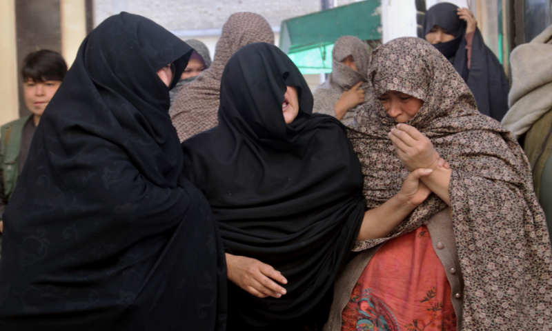 Women from the Shia Hazara community mourn for coal mine workers who were killed by gunmen near the Machh coal field, prior to their funeral in Quetta on Saturday. — AP