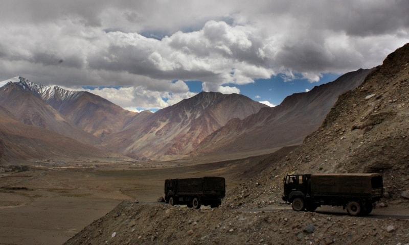 In this 2017 file photo,  Indian army trucks drive near Pangong Tso lake near the India China border in India's Ladakh area. — AP