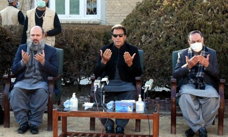 Prime Minister Imran Khan prays for the slain coal miners. — Photo courtesy: Prime Minister's Office
