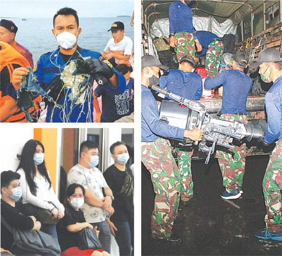 CLOCKWISE: A member of the rescue team looking for an Indonesian plane that lost contact after taking off from the capital Jakarta holds suspected debris, at sea, on Saturday. Marines load supplies and equipment on a ship for a search and rescue operation for the Sriwijaya Air flight in Jakarta. People wait for news on their relatives who were on board the ill-fated flight.—Reuters/AFP/AP