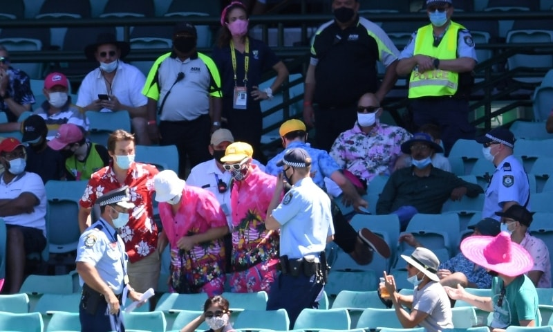 Police remove a group of spectators from their seats after Mohammed Siraj of India complained to umpires of being racially abused during day four of the third Test match between Australia and India at the SCG, Sydney, Australia, January 10. — Reuters