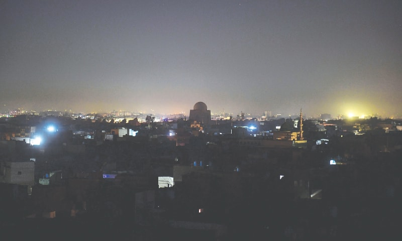 A VIEW of the city's central area during midnight nationwide power breakdown that prolonged into Sunday morning.—AFP