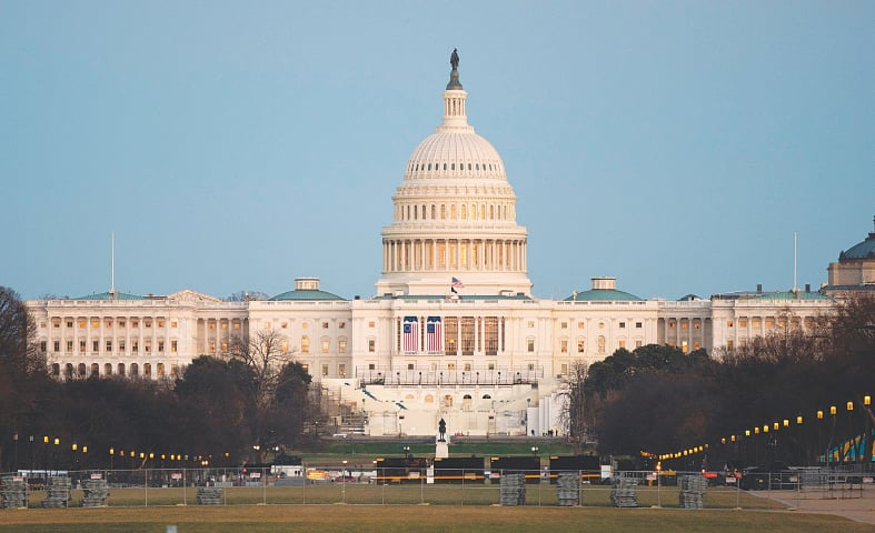 WASHINGTON: Security fences are being set up near the US Capitol in the wake of the attack on Wednesday.—AFP