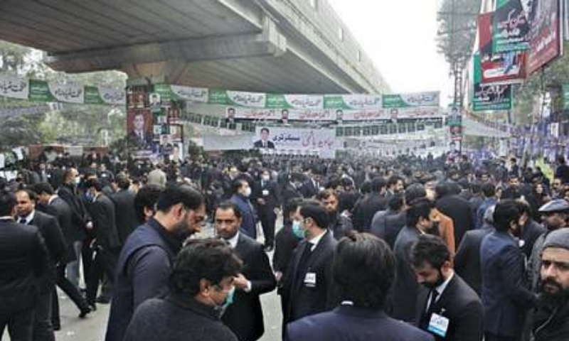Lawyers gather outside the Aiwan-e-Adl to elect Lahore Bar Association office-bearers on Saturday. — White Star