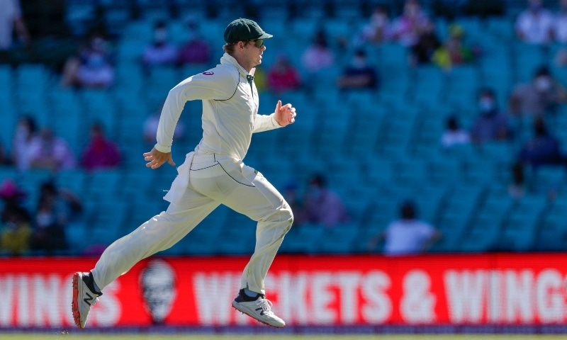 Australia's Steve Smith runs to field the ball during play on the final day of the third cricket test between India and Australia at the Sydney Cricket Ground. — AP