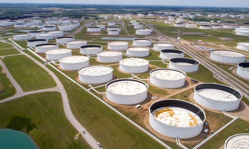 Crude oil storage tanks are seen in an aerial photograph at the Cushing oil hub. — Reuters/File