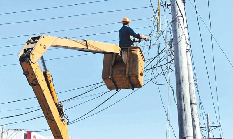 In this file photo, a Fesco worker is seen repairing electricity wires. —APP