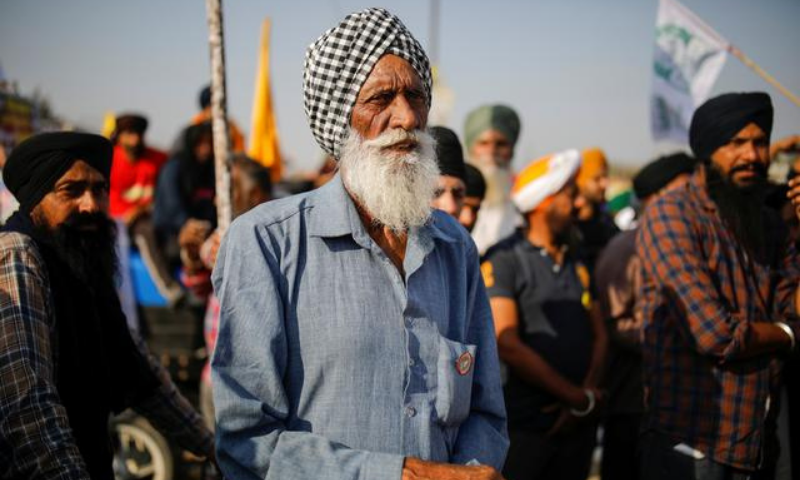 In this file photo, farmers listen to a speaker during a protest against the newly passed farm bills at Singhu border near New Delhi, India on December 9. — Reuters