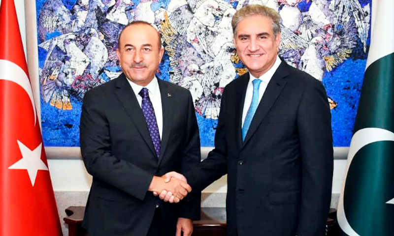 In this Sept 2018 file photo, Foreign Minister Shah Mahmood Qureshi shakes hands with Turkish counterpart Mevlut Cavusoglu in Islamabad. —AP