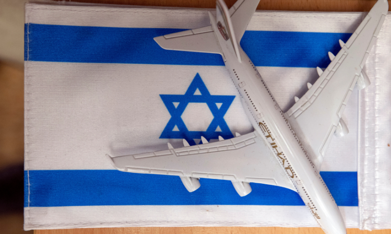 An Israeli flag and a model of an Etihad plane are seen in the office where team members of the Arabic-language social media unit work, at the Israeli foreign ministry in Jerusalem December 1, 2020. — Reuters