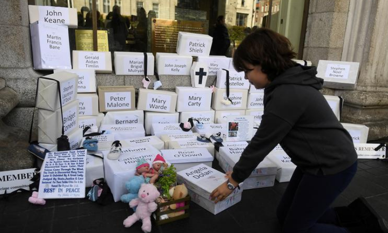 In this file photo, funeral boxes, each representing a dead child, are placed together at a procession in remembrance of the bodies of the infants discovered in a septic tank, in 2014, at the Tuam Mother and Baby Home, in Dublin, Ireland. — Reuters