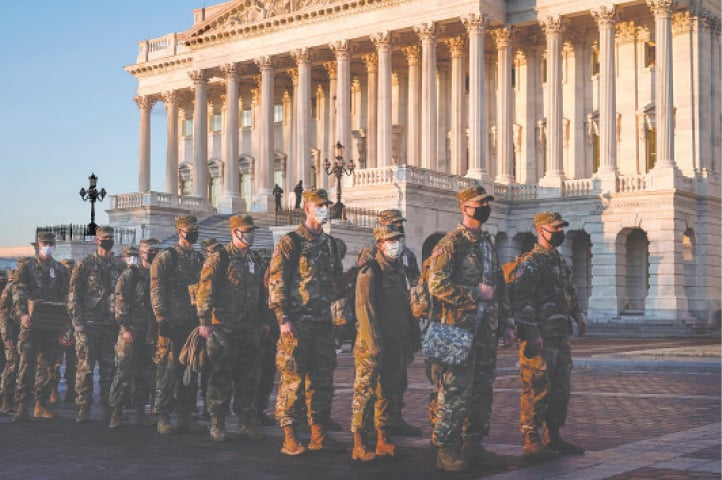 WASHINGTON: Members of the National Guard arrive at the US Capitol as Democratic members of the House prepare articles of impeachment against President Donald Trump on Tuesday.—Reuters