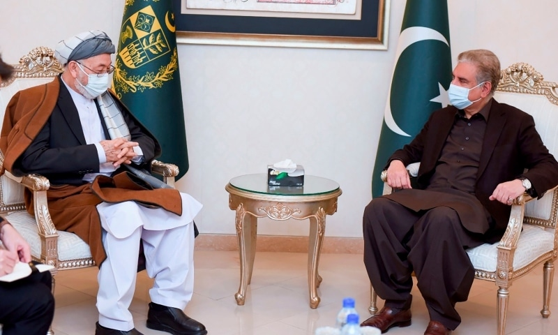 In this photo provided by Pakistan's Ministry of Foreign Affairs, Karim Khalili, left, an influential Afghan Shiite leader, meets with Pakistani Foreign Minister Shah Mahmood Qureshi at Foreign Ministry in Islamabad on Jan 12. — AP