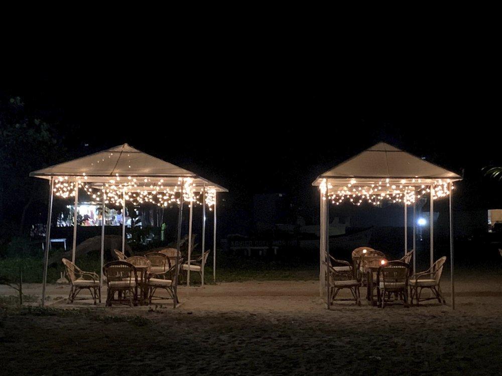 Empty shacks at the Morjim beach on the Arabian Sea coast at night in Goa