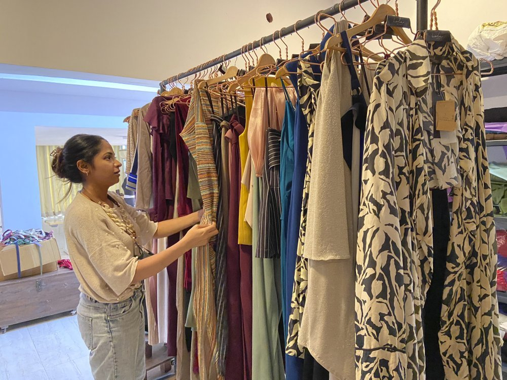 Designer Suman Bhat browses through a display of her collections at Panjim in Goa.
