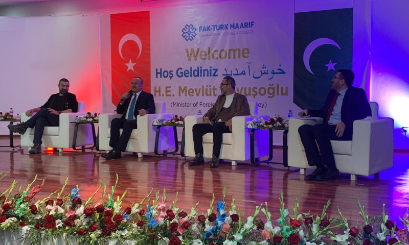 Turkish Foreign Minister Mevlut Cavusoglu attends an event at the Pak-Turk school along with two actors from the TV series Ertugrul. — Photo by Naveed Siddiqui