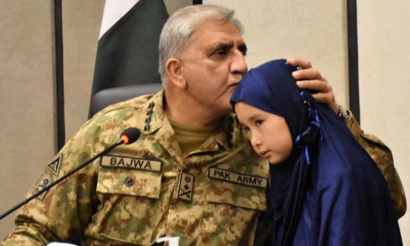 Army Chief Gen Qamar Javed Bajwa kisses the forehead of a Hazara girl during his visit to Quetta on Wednesday. — Photo courtesy: ISPR