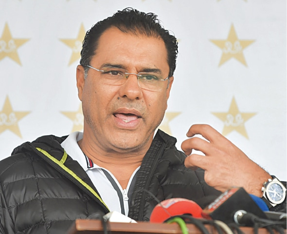 PAKISTAN bowling coach Waqar Younis addresses the media conference at the Gaddafi Stadium on Wednesday.—M. Arif/White Star
