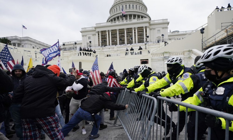In this Jan 6 photo, Trump supporters try to break through a police barrier at the Capitol in Washington. — AP