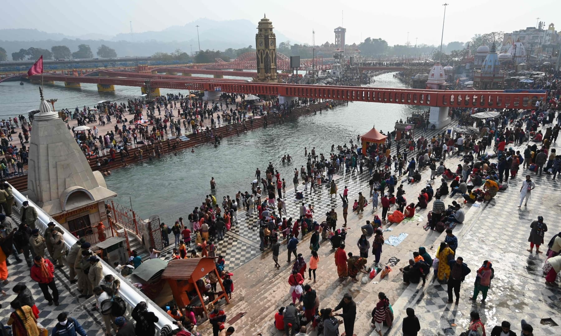 A general view shows Hindu devotees taking a holy dip in the waters of the River Ganges during Makar Sankranti, on the first day of the religious Kumbh Mela festival in Haridwar on January 14. — AFP