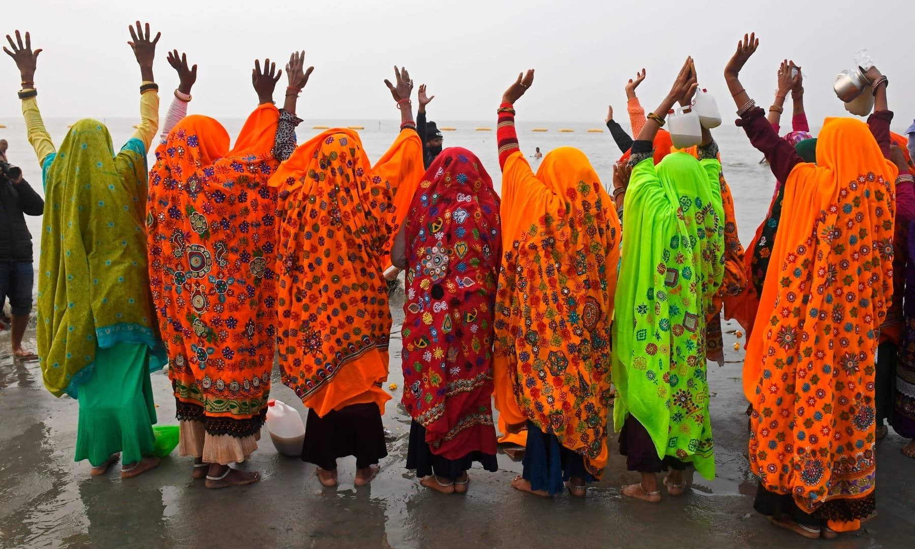 Hindu pilgrims pray after taking a holy dip at the confluence of the Ganges and the Bay of Bengal during the Gangasagar Mela on the occasion of Makar Sankranti, at Sagar Island, around 150km south of Kolkata on January 14. — AFP