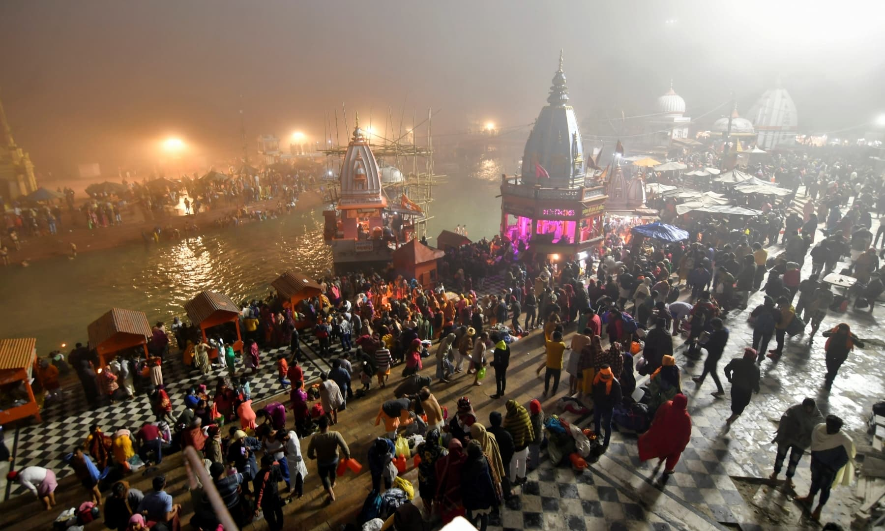 """Hindu devotees gather to take a holy dip in the waters of river Ganges to mark """"Makar Sankranti"""" festival, amidst the spread of the coronavirus disease, in Haridwar, India, January 14. — Reuters"""