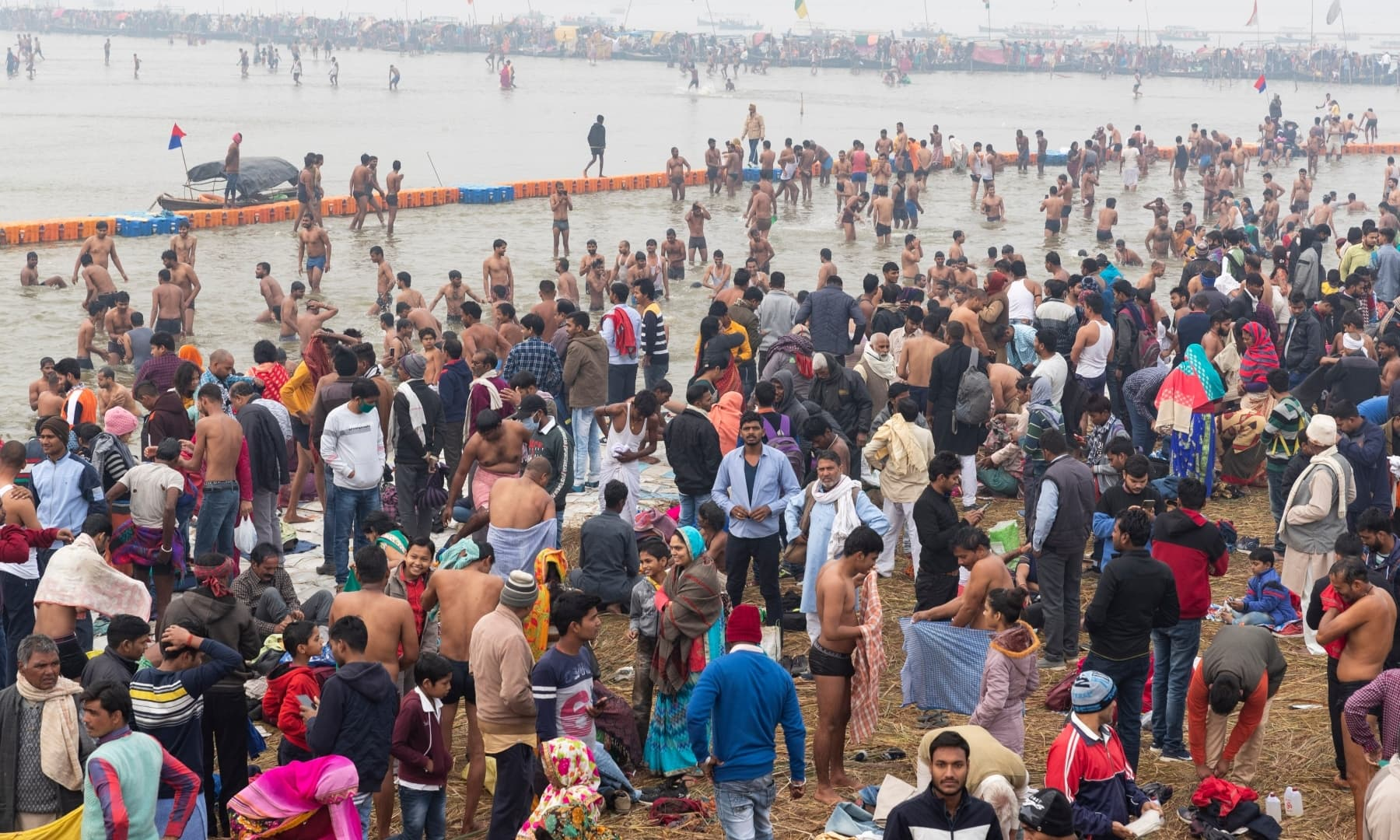 Hindu devotees crowd the confluence of the Ganges and Yamuna rivers to take a ritualistic bath during Makar Sankranti festival in Prayagraj, India, Thursday. — AP