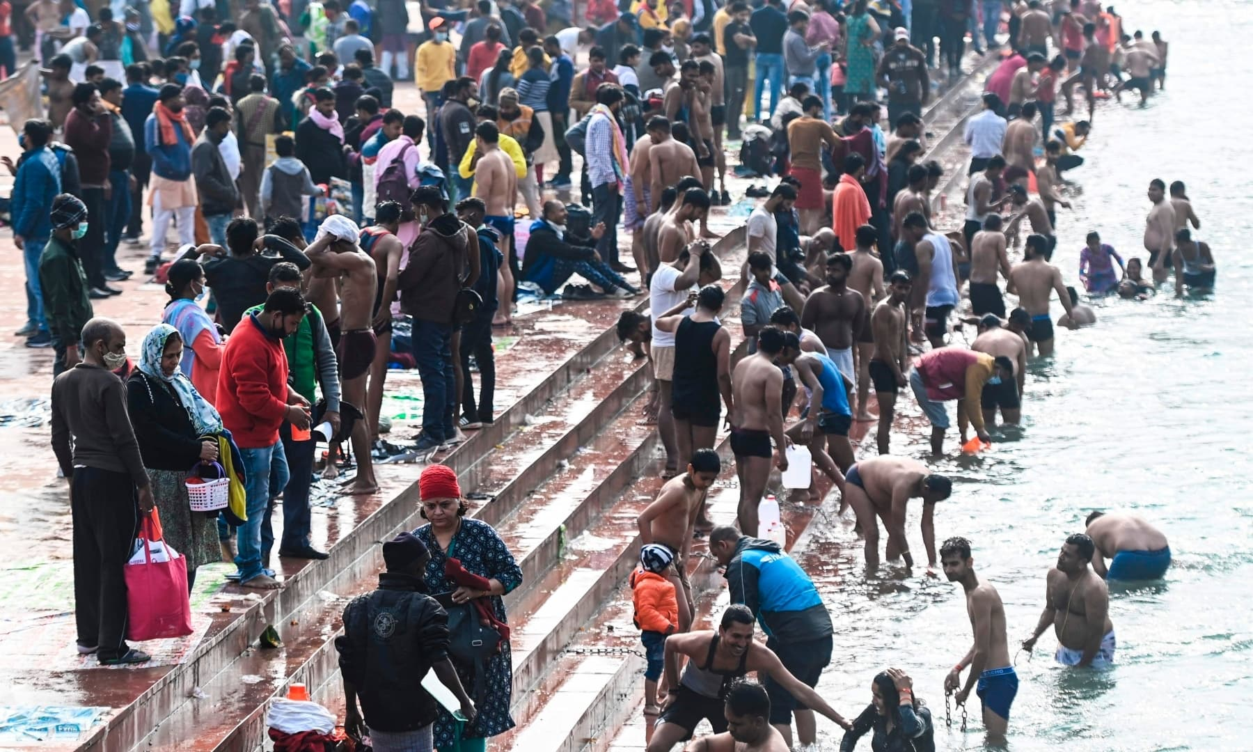 Hindu devotees take a holy dip in the waters of the River Ganges during Makar Sankranti, on the first day of the religious Kumbh Mela festival in Haridwar on January 14. — AFP