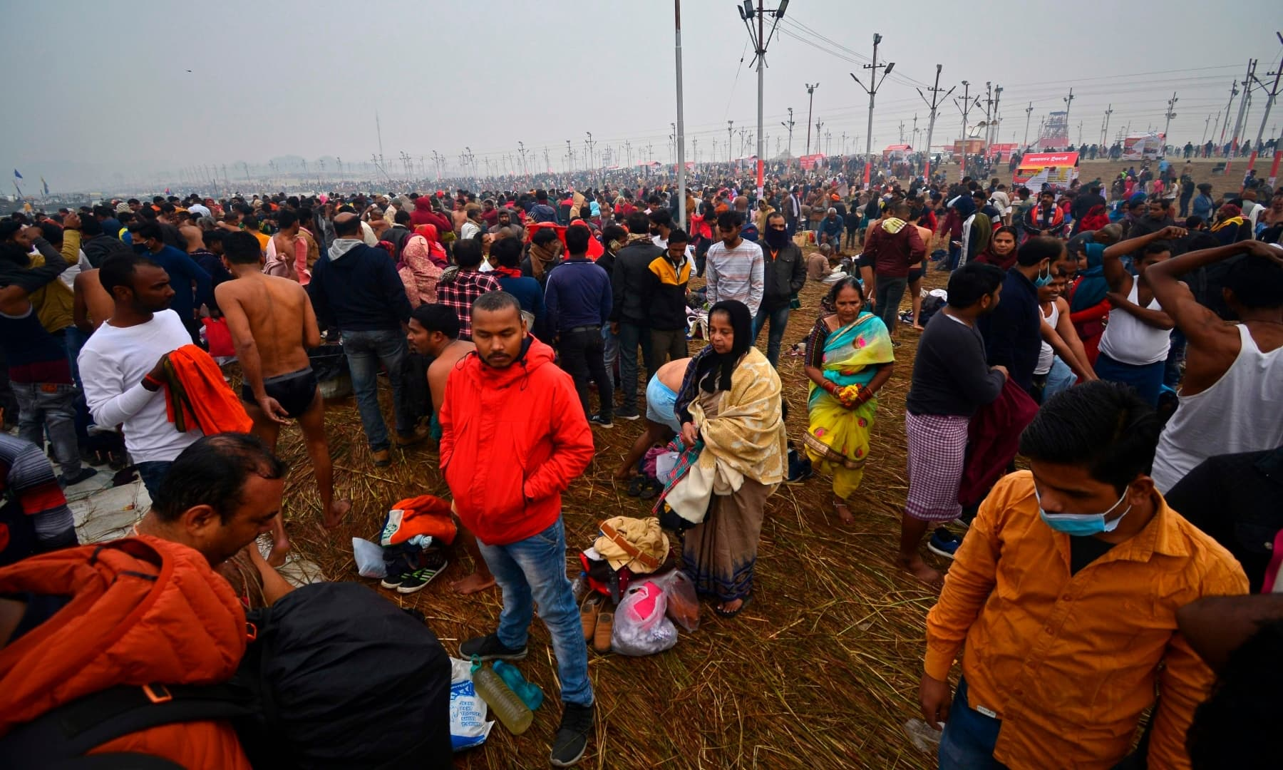 Hindu devotees crowd the banks of Sangam, the confluence of rivers Ganges, Yamuna and the mythical Saraswati, on the occasion of Makar Sankranti, in Allahabad. — AFP