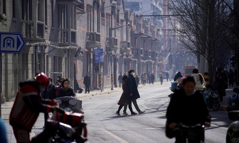 A man wearing a face mask crosses a street following the coronavirus disease outbreak, in Shanghai, China Jan 14, 2021. — Reuters