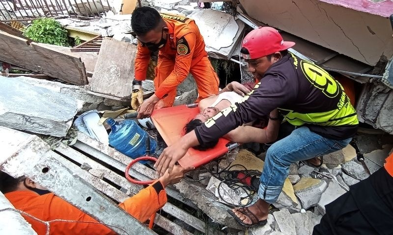 Rescuers evacuate a man from a hospital building which collapsed following an earthquake in Mamuju, West Sulawesi province, Indonesia, Jan 15, 2021. — Reuters