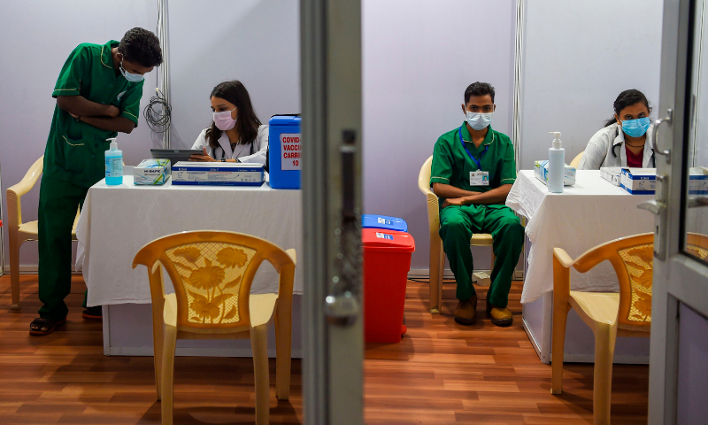 Medical staff work inside a Covid-19 vaccination centre in Mumbai on January 15, 2021, a day before India starts the first phase of vaccination across the country. — AFP