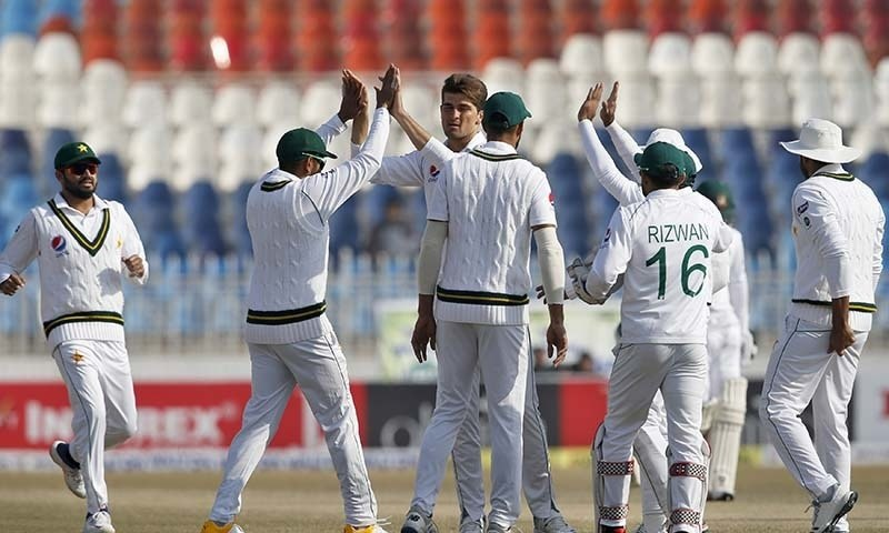 Pacer Shaheen Shah Afridi, centre, celebrates with teammates after taking the wicket of Bangladesh Mominul Haque during the fourth day of their 1st Test against Bangladesh at Rawalpindi cricket stadium in Rawalpindi on February 10, 2020.— AP/File