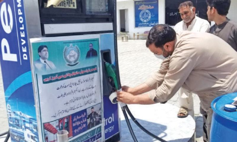 On the directive of Prime Minister Imran Khan, 609 fuel stations across the country have been sealed with about 4.5 million litres of petrol and diesel seized under a strict drive against smugglers. — Dawn/File