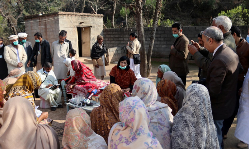Special Assistant to the Prime Minister on Poverty Alleviation and Social Protection Dr Sania Nishtar interacts with women in Rawalpindi on Friday. — PID