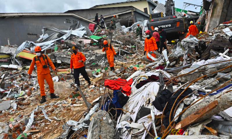 Rescuers search for survivors at a collapsed building in Mamuju city on January 16, 2021, a day after a 6.2-magnitude earthquake rocked Indonesia's Sulawesi island. — AFP