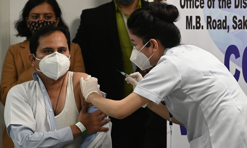 A medical worker inoculates a colleague with a Covid-19 vaccine at the All India Institute of Medical Science (AIIMS) in New Delhi on Saturday. — AFP