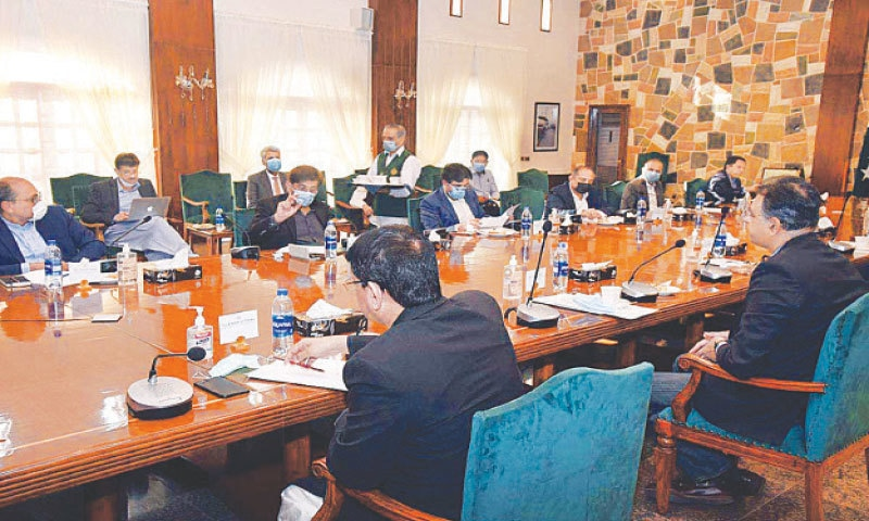 A meeting of the Karachi Coordination Committee under way on Saturday at CM House. — APP