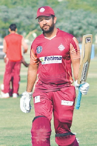 SOUTHERN Punjab's Sohaib Maqsood returns after scoring 101 against Khyber Pakhtunkhwa at the NBP Sports Complex on Saturday.—PCB