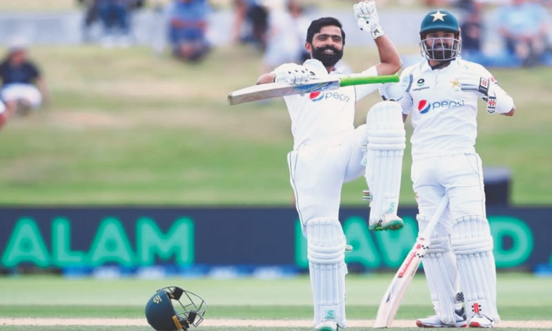 Fawad Alam celebrates his 100 against New Zealand in the first Test at the Bay Oval.