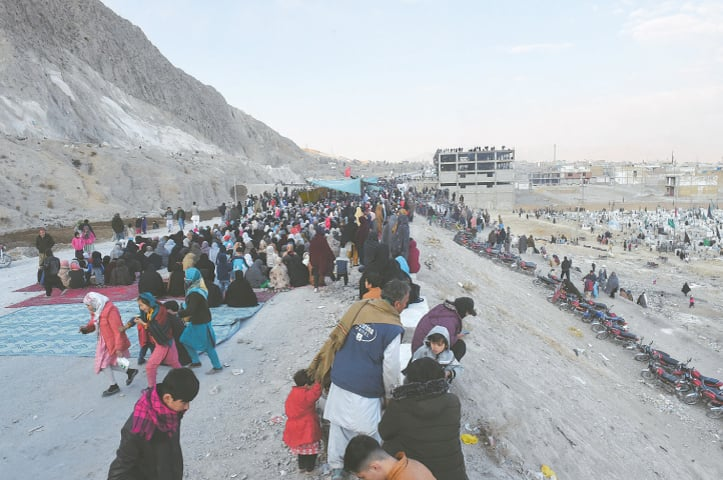 Mourners gather on the Western Bypass on the outskirts of Quetta | B K Yousafzai