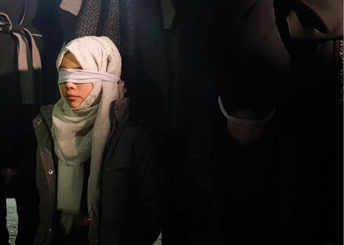Young Hazara women wear blindfolds at a sit-in, the way 10 coal miners from their community were blindfolded before they were killed by militants | Habib Qasimi
