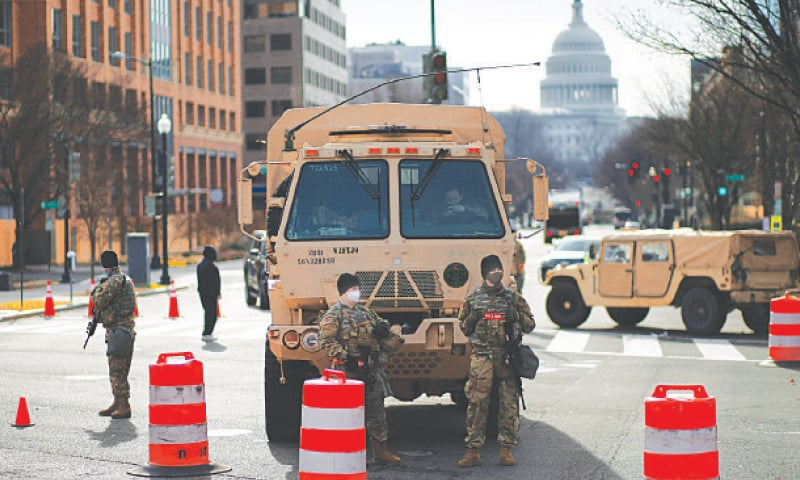 Members of the National Guard secure the area near the Capitol for possible protest ahead of US President-elect Joe Biden's inauguration in Washington.—Reuters