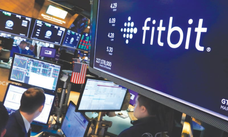 The logo for Fitbit appears above a trading post on the floor of the New York Stock Exchange. Google has completed its $2.1 billion acquisition of fitness-gadget maker Fitbit. It's a deal that could help the internet company grow even stronger while US government regulators pursue an antitrust case aimed at undermining its power. Last week the completion of the acquisition comes 14 months after Google announced a deal that immediately raised privacy alarms.—AP