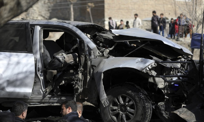 Afghan security officers inspect the site of a bomb attack in Kabul, Afghanistan on Saturday. — AP