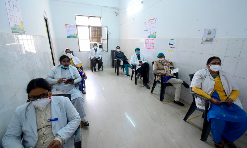 A medical worker (L) registers the details of his colleague for a Covid-19 vaccine at the Institute of Kidney Diseases and Research Centre (IKDRC) in Ahmedabad on January 16. — AFP