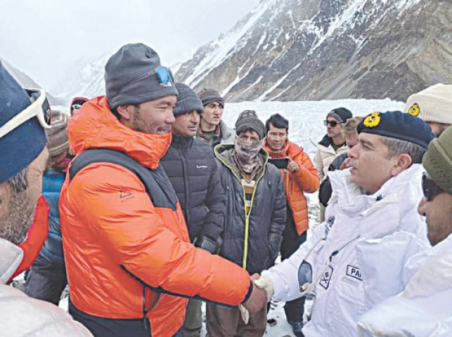 COMMANDER FCNA Maj Gen Jawad Ahmed shakes hands with a member of the climbers' team that made history on Saturday by scaling K2 in winter. During his visit to the K2 base camp on Sunday, Maj Gen Ahmed congratulated the Nepalese climbers on their feat.—Dawn